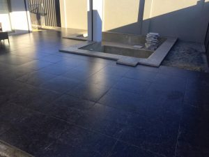Dark paving in alfresco area of Perth home.
