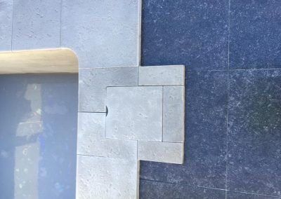 Close up of dark stone paving as it contrasts against limestone