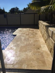 Limestone Paving in front of a retaining wall