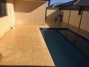 Limestone pavers around pool area in Perth home