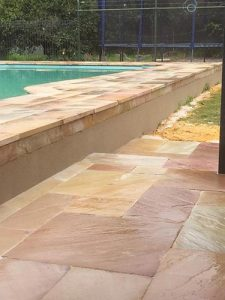 backyard-limestone-wall-around-pool